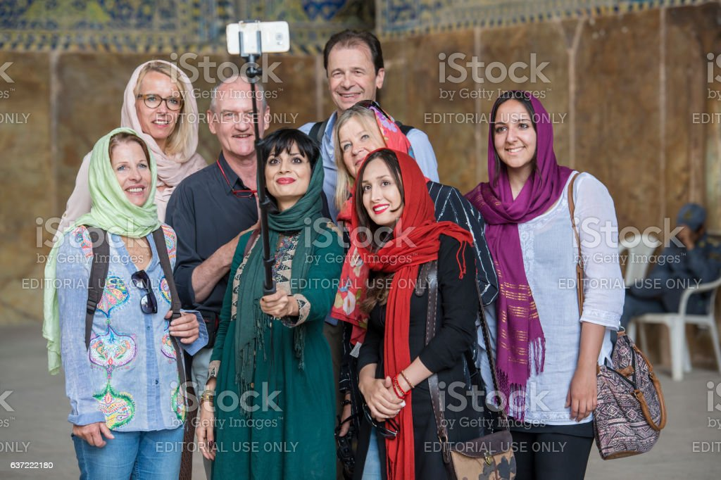 Local and foreign tourists take a selfie, Shah Mosque, Isfahan stock photo