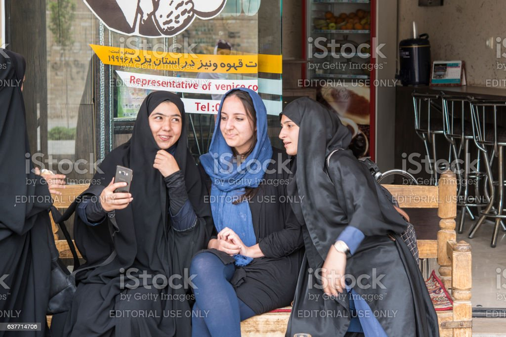 Local and foreign women taking a selfie, Yazd, Iran stock photo