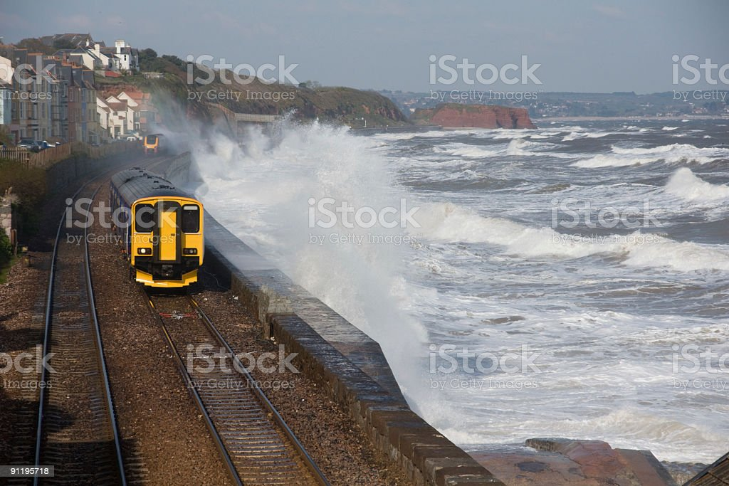 Local and high speed trains during a storm near Dawlish stock photo