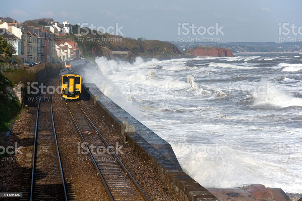 Local and high speed trains during stormy conditions stock photo