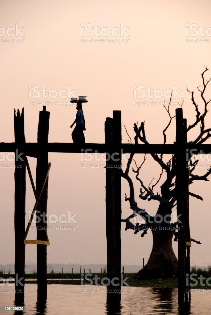 Local balancing tray across U Bein Bridge, Myanmar stock photo