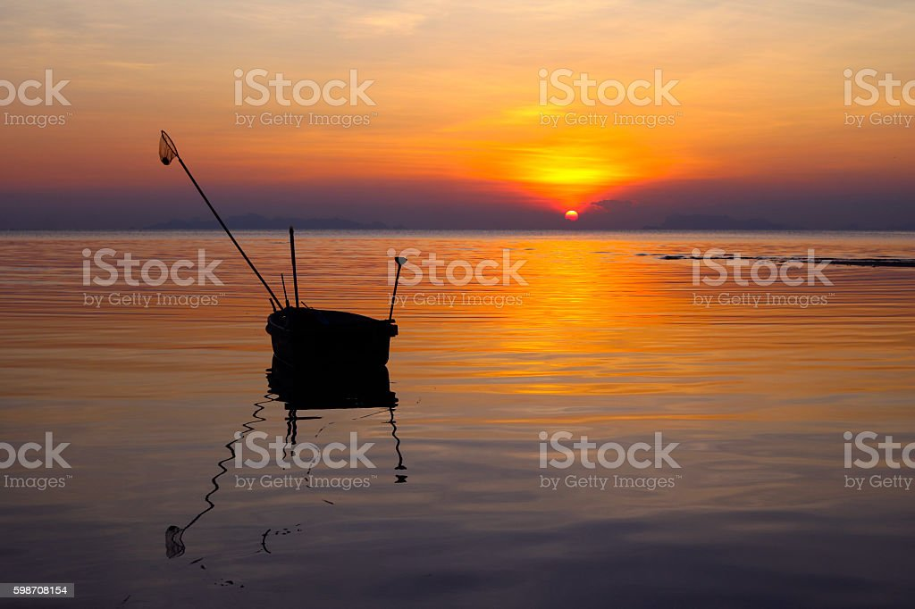 Local  boat with sunset in Thailand. stock photo