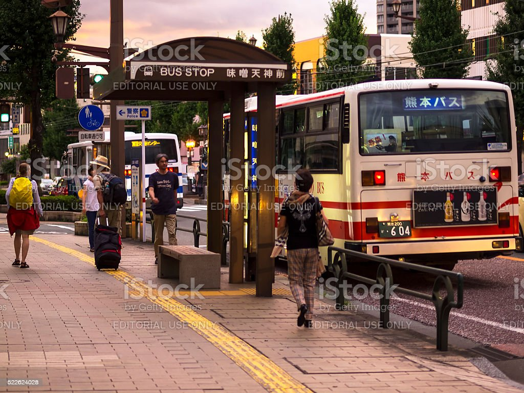Local bus station on Kumamoto street at evening stock photo