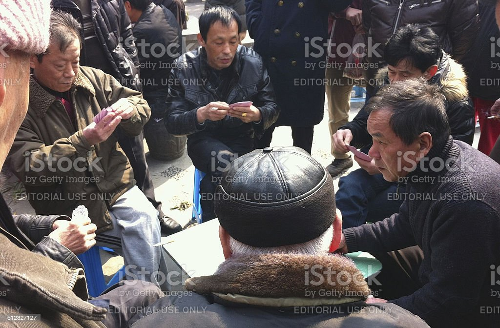 Local Card Huddle, Peoples Park, Hongkou, Shanghai, China. stock photo