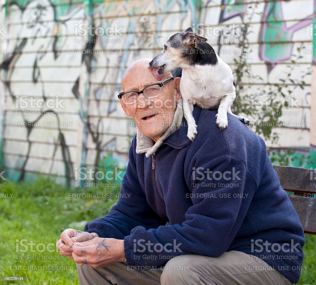 Local Character and Beloved Dog. stock photo