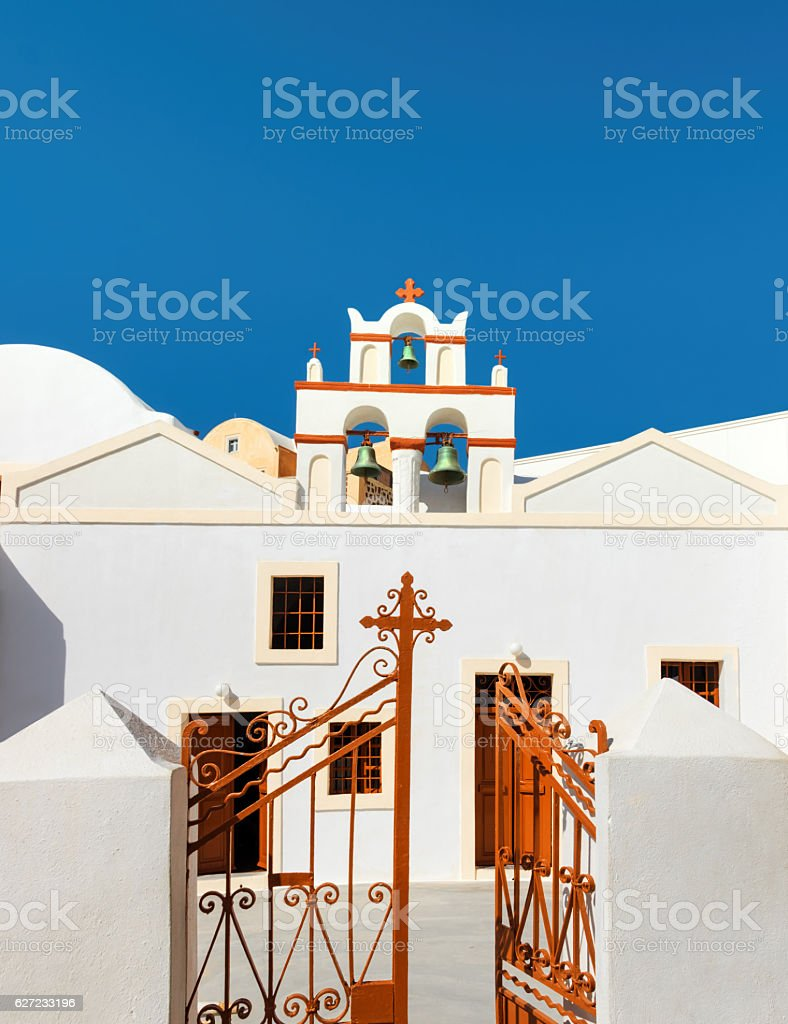 Local church with bell tower in Oia, Santorini, Greece stock photo