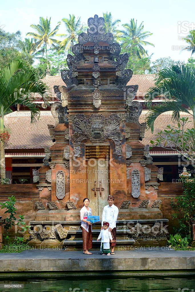 Local family in temple at Bali stock photo