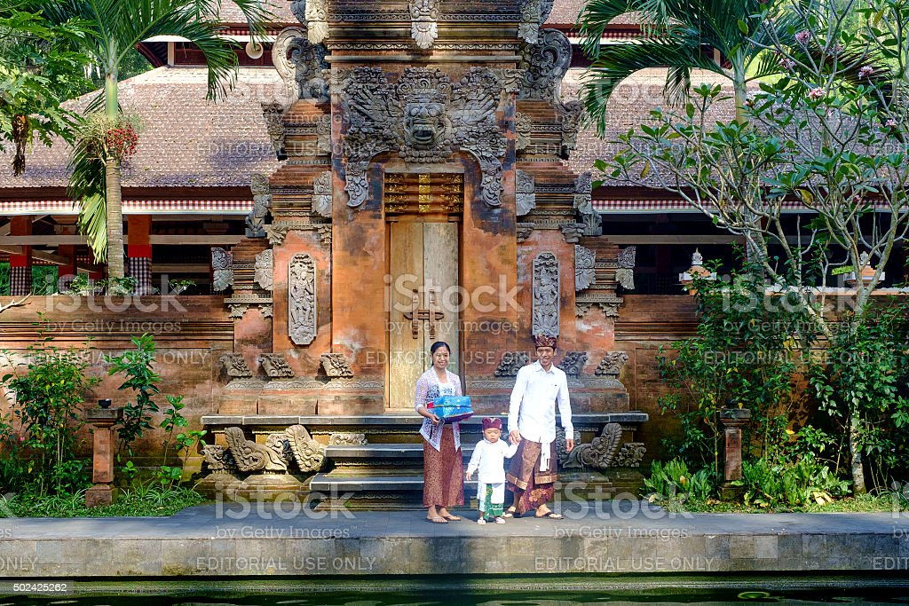 Local family in the temple at Ubud. stock photo