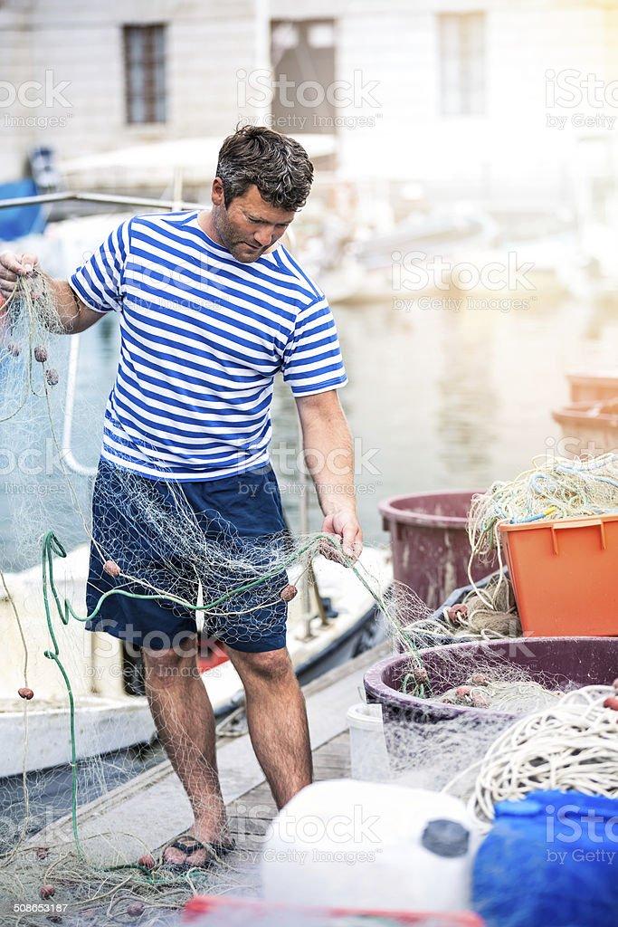 Local Fisherman At Work stock photo