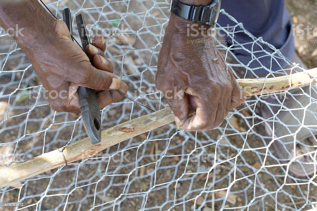 Local Fisherman Making A Fish Pot stock photo