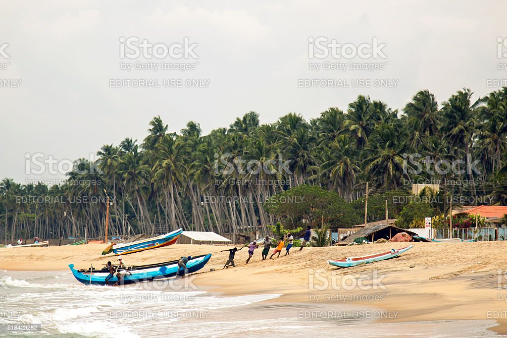 local fishermen dragged the boat stock photo