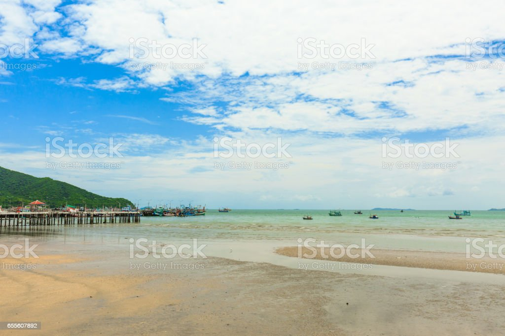 Local fishing boat parked beside the beach in Thailan stock photo