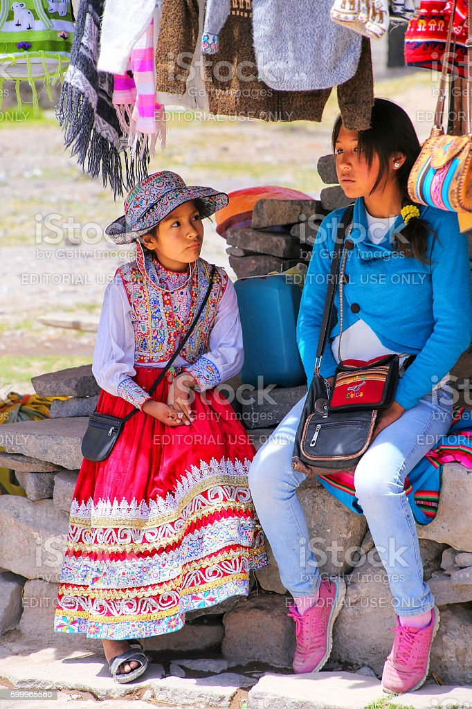 Local girls sitting at the market in Maca village stock photo
