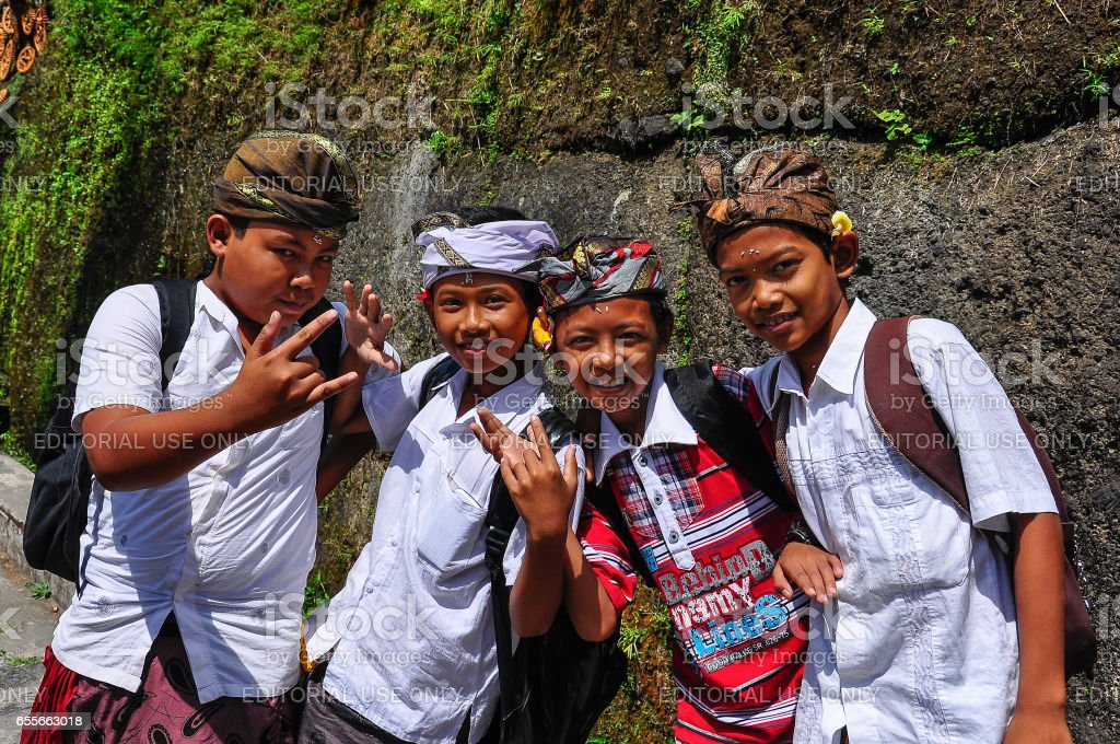 Local kids around the Gunung Kawi site in Bali, Indonesia stock photo