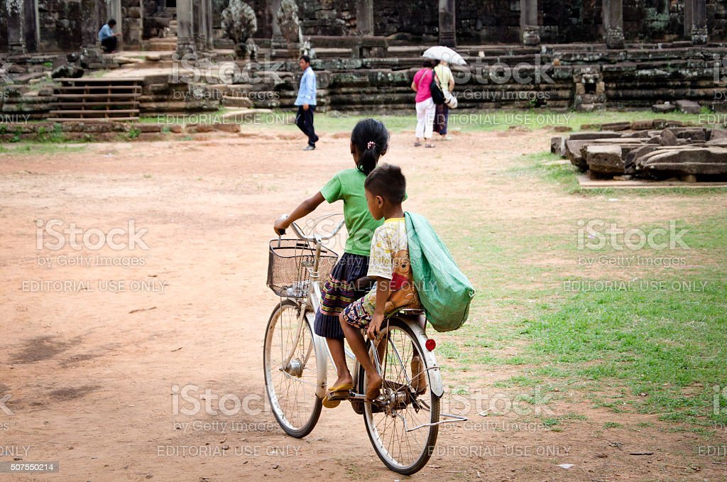 Local Kids outside Bayon Temple, Siem Reap, Cambodia stock photo