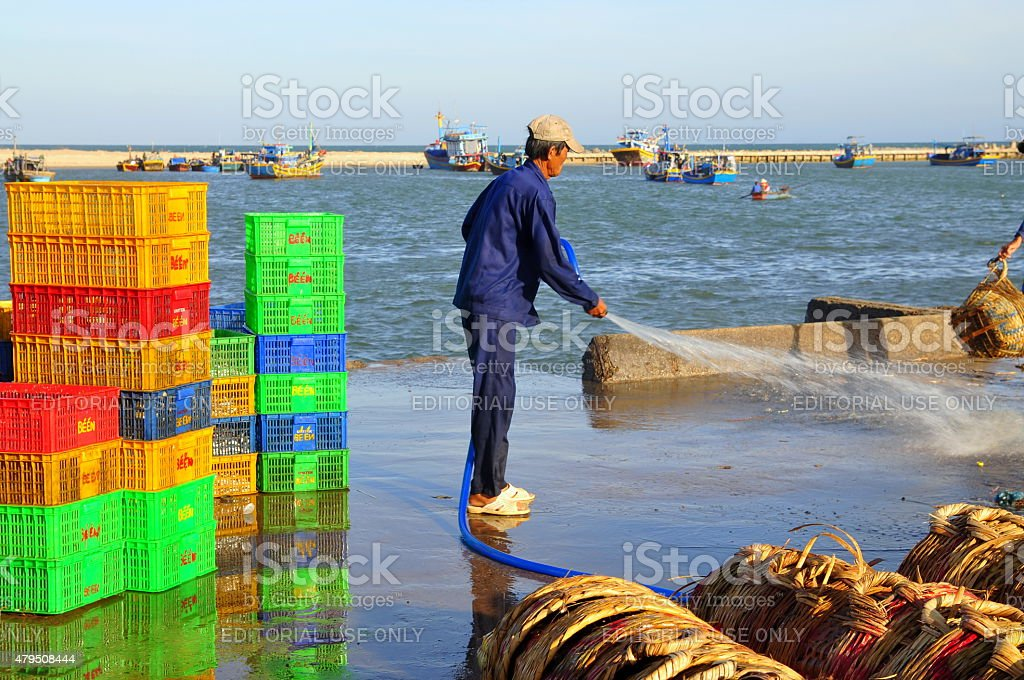 Local man is cleaning his fisheries baskets stock photo