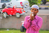 Local man making soap bubbles at Man Sagar Lake