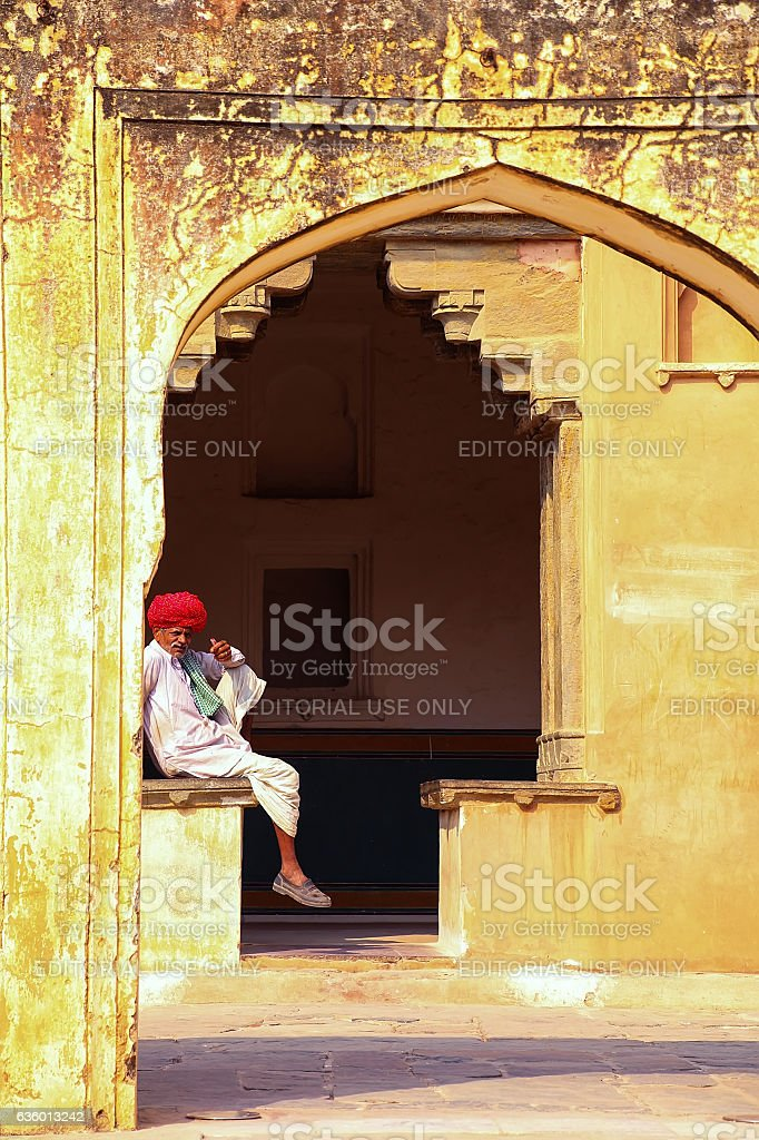 Local man sitting in the fourth courtyard of Amber Fort stock photo