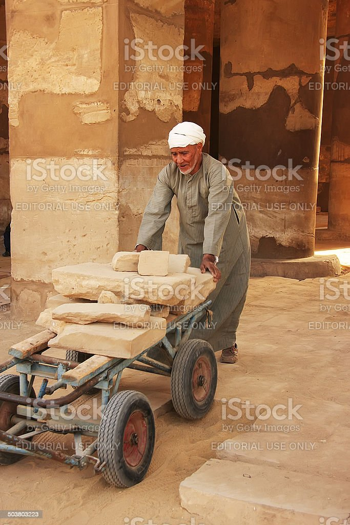 Local man working at Karnak temple complex, Luxor royalty-free stock photo
