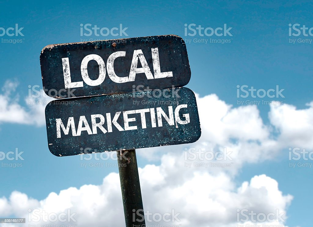 Local Marketing sign with clouds and sky background stock photo