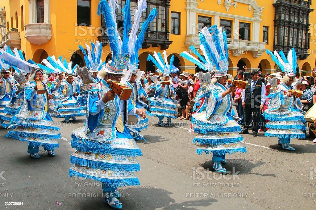 Local men dancing in Lima, Peru stock photo
