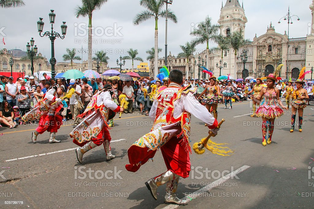Local men dancing in Lima, Peru stock photo