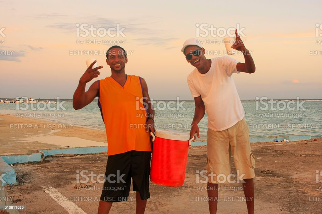 Local men having party at Boca Chica beach stock photo