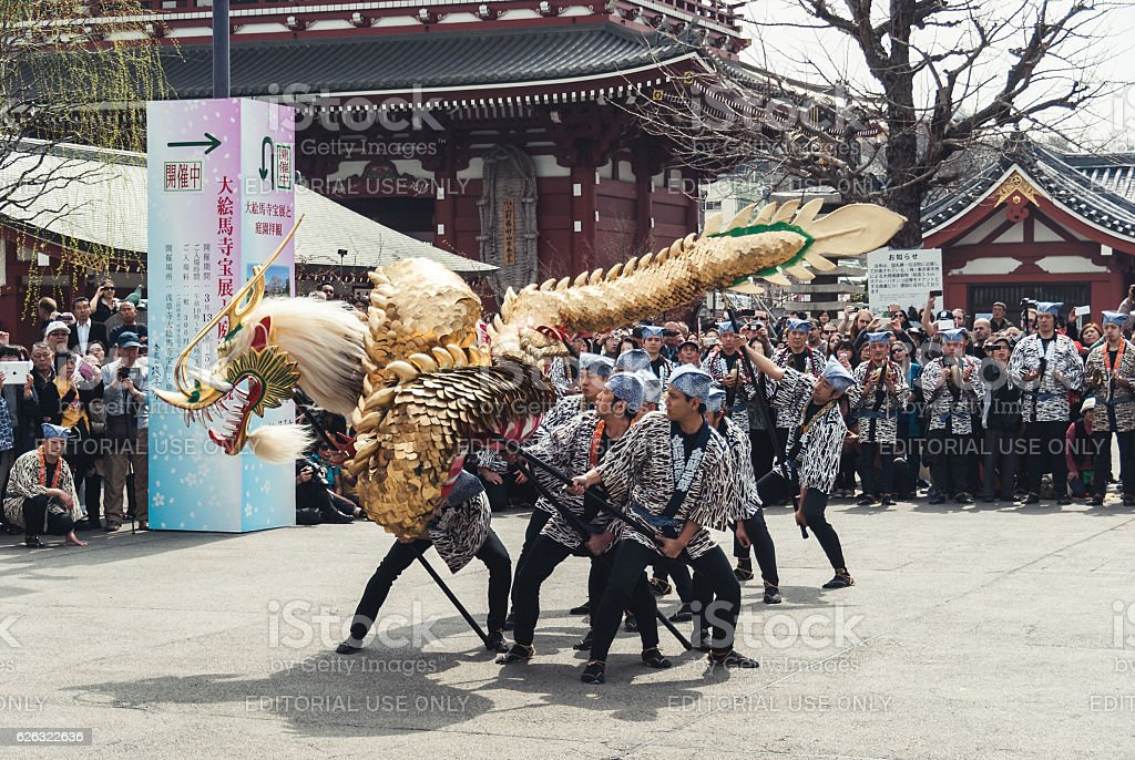 Local men performing the Golden Dragon Dance 'Kinryu no mai' stock photo