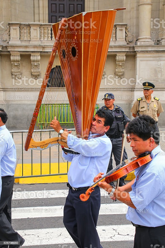 Local men playing music in Lima, Peru stock photo