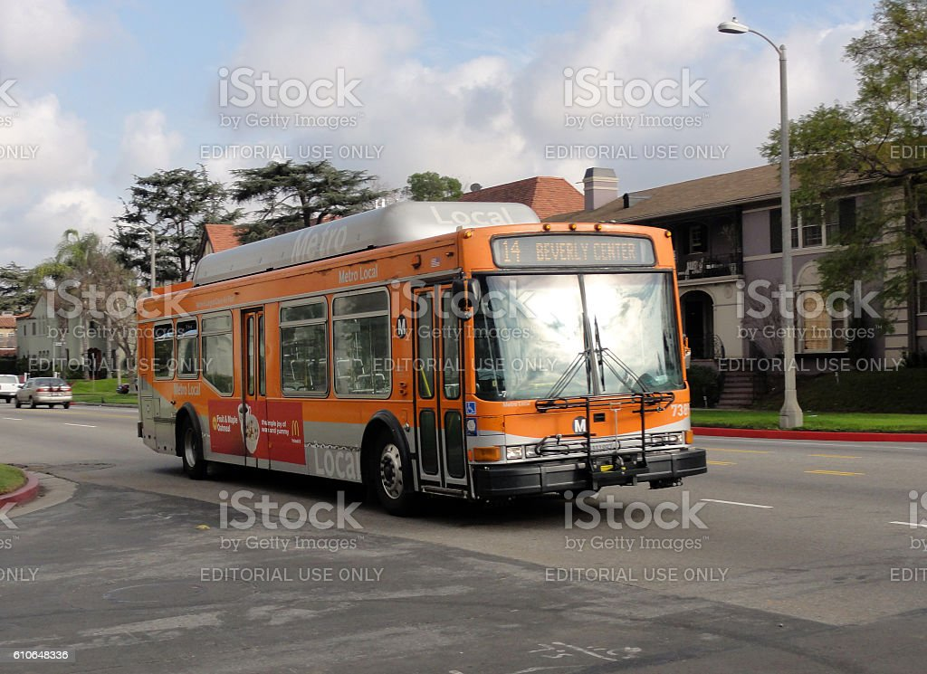 Local Metro Bus rolls down the street stock photo