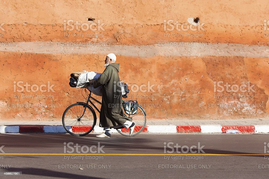 Local old man in Marrakech against the Medina Wall royalty-free stock photo