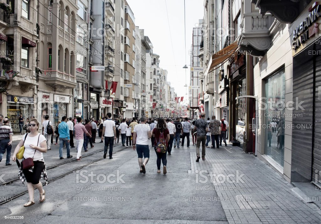 Local people and tourists walk on Istiklal Avenue stock photo