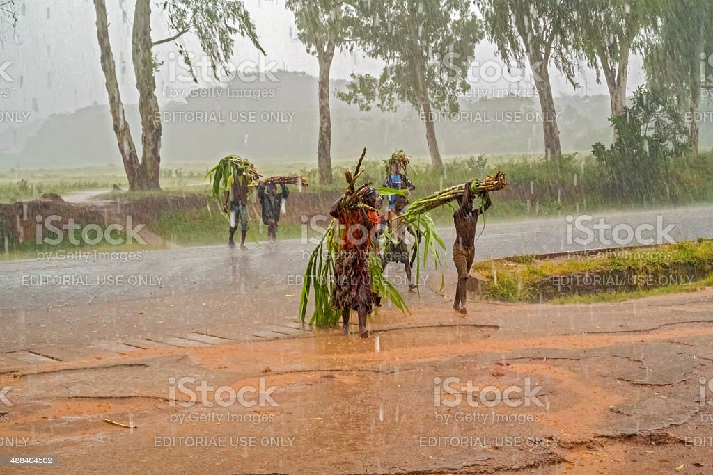 Local people crossing the road in Malawi stock photo