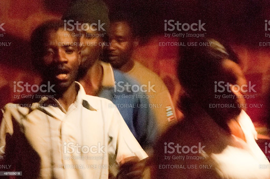Local people in Namibia dancing and singing in the evening stock photo