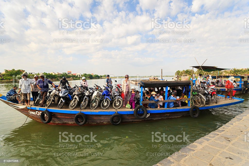 Local people on boat, Bach Dang wharf, Hoi An, Vietnam stock photo