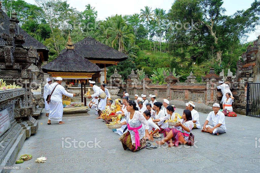 Local People praying at Pura Tirtha Empul. stock photo