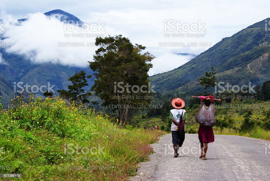 Local people seen during hiking in Baliem Valley, Indonesia stock photo