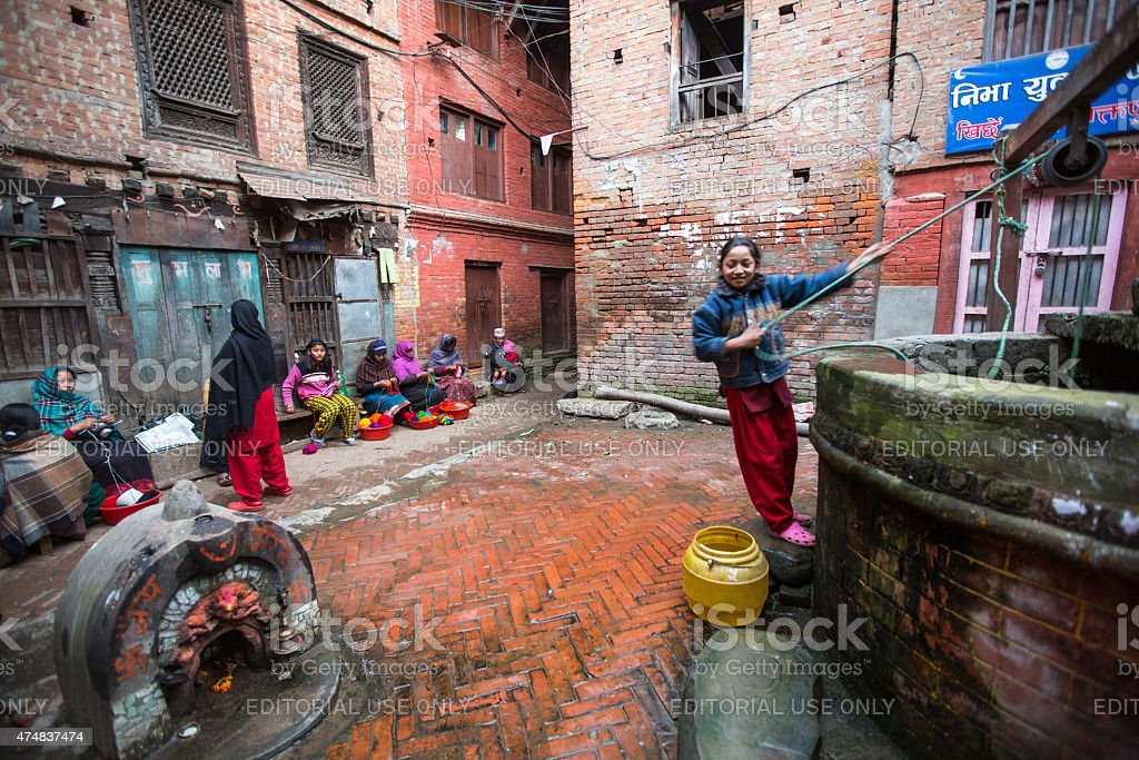 Local people sit in the street. Bhaktapur, Nepal. stock photo