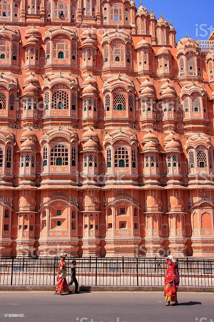 Local people walking in front of Hawa Mahal in Jaipur stock photo