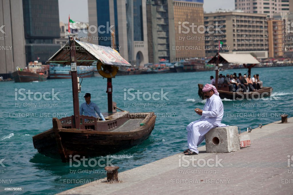 Local person and water boat owner at Dubai of UAE royalty-free stock photo