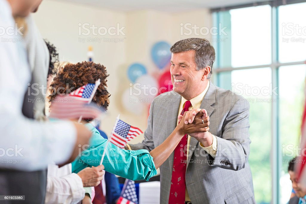 Local politician shaking hands with supporter during rally stock photo