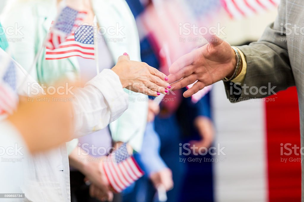 Local politician shaking hands with supporters at event stock photo