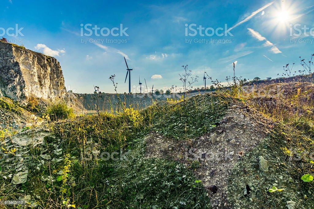 Local quarry with wind turbine stock photo