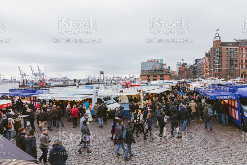 Local residents and tourists in the fish market in Hamburg. stock photo