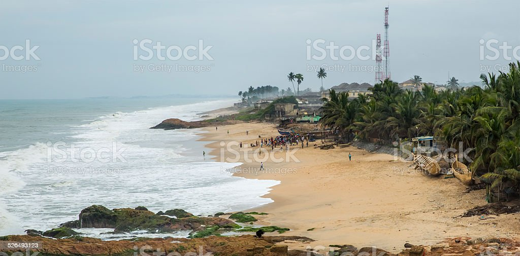 Local residents at the ocean shore in Ghana stock photo