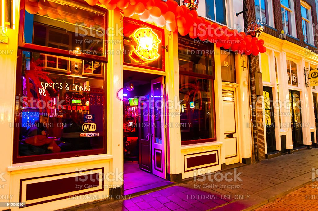 Local restaurant in red light district invites guests. stock photo
