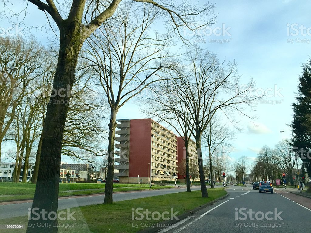 Local street with appartments in the neighborhood 'Wesselerbrink' in Enschede stock photo