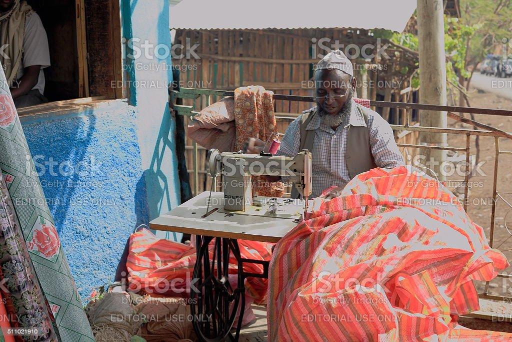 Local taylor at work. Degan town-Ethiopia. 0102 stock photo