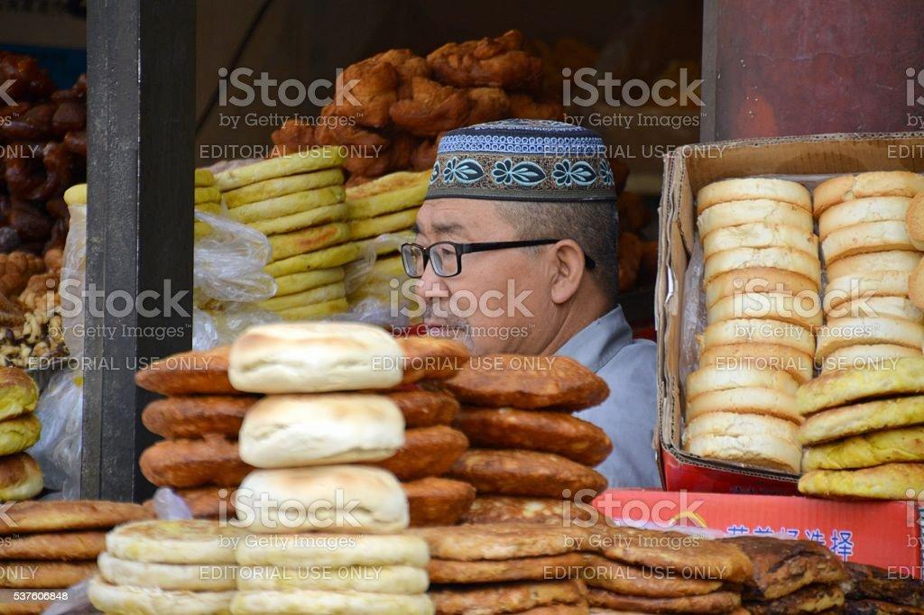 Local vendor at Bakery in Hohhot Muslim Quarter, Inner Mongolia stock photo