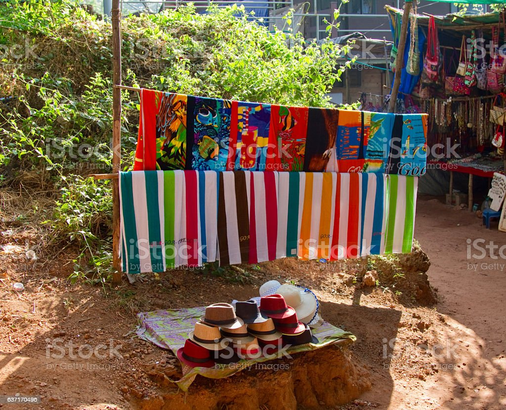 Local vendor's stall with beach towels and hats in Goa stock photo
